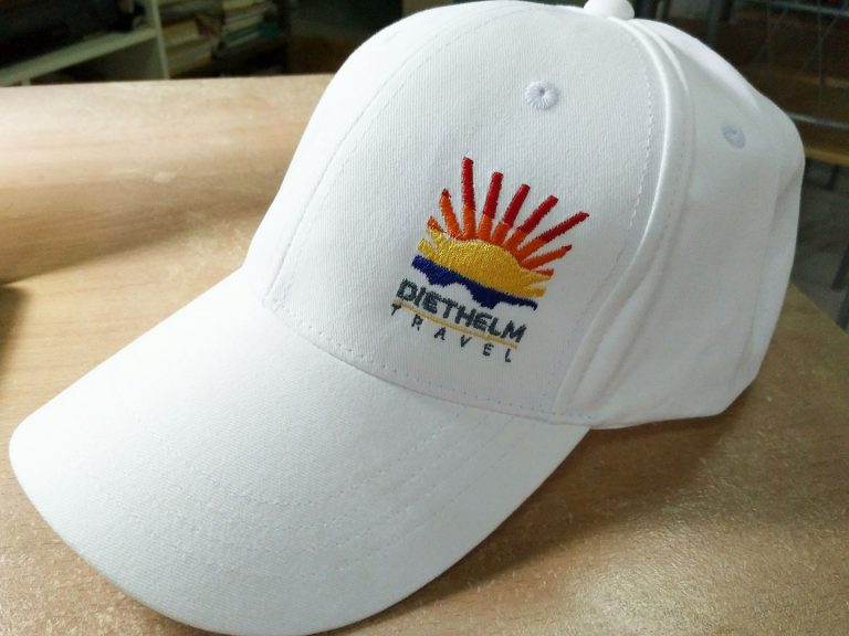 งานปักหมวก Diethelm Travel