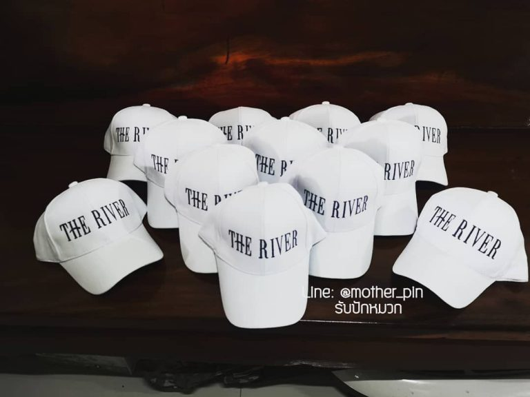 ขายหมวกพร้อมปักสำหรับคอนโด The River